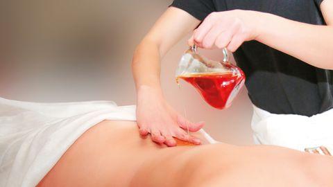 Massage du dos Vitalis avec huile d'aromatique