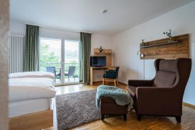 Room • Lake • View   (NATURE TITISEE, ca. 200 m oberhalb des Boutique-Hotels)