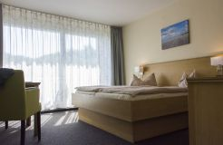 Organic double room with balcony, first floor (2/3) - Biohotel Strandeck