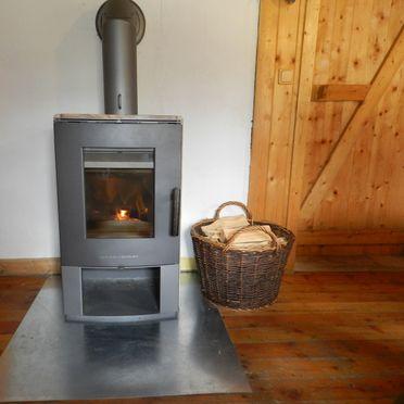 Ranahütte, Schwedenofen in der Wohnstube